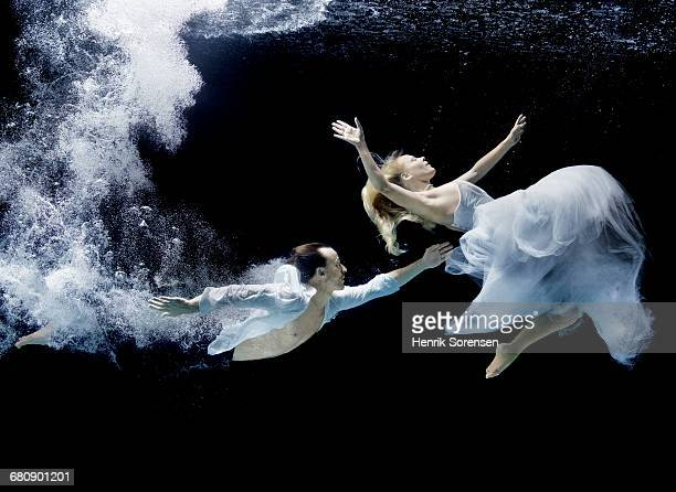 A couple swimming under water