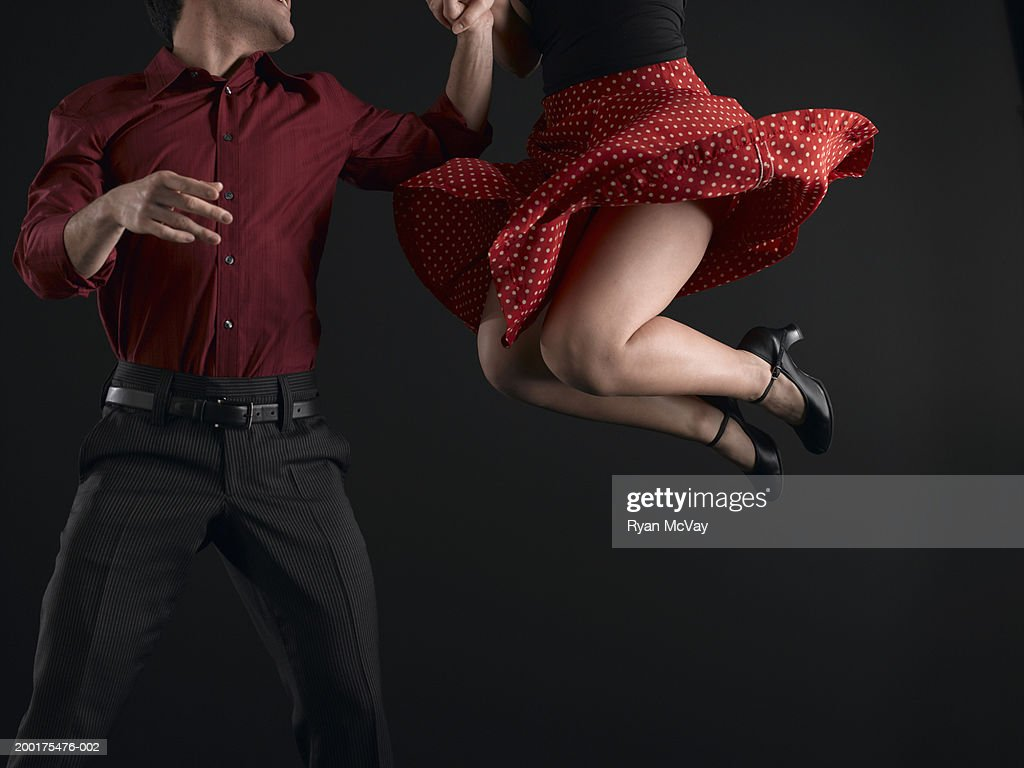 Couple swing dancing, low section : Stock Photo