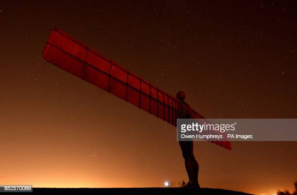 A couple take a photo in front of the Angel of the North in Gateshead Tyne and Wear as temperatures dropped to near freezing overnight