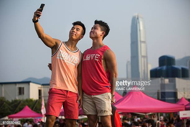 A couple take a 'selfie' at Pink Dot a lesbian gay bisexual transgender/transsexual and intersex carnival in the West Kowloon district of Hong Kong...