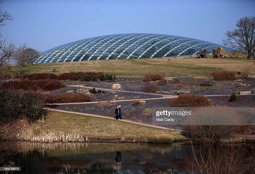 A couple take a walk to the lake in front of the Norman Foster designed Great Glasshouse at the National Botanic Garden of Wales on March 5, 2013 near Carmarthen, Wales. As the weather improves, staff at the gardens - which opened in 2000, stretches over 500 acres and contains the largest single span glasshouse in the world - are gearing up for the arrival of the spring season.