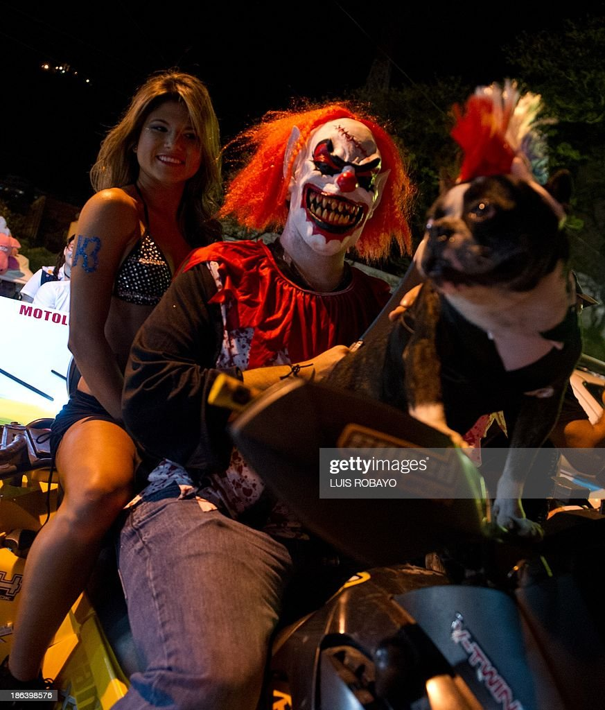 A couple take part in 'Moto-Halloween Party 2013' on October 30, 2013, in Cali, Valle del Cauca department, Colombia. AFP PHOTO/Luis ROBAYO