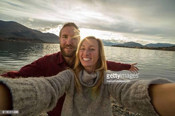 Couple take selfie at lake Wanaka