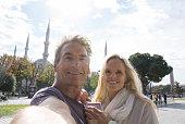 Couple take selfie portrait, Blue Mosque behind
