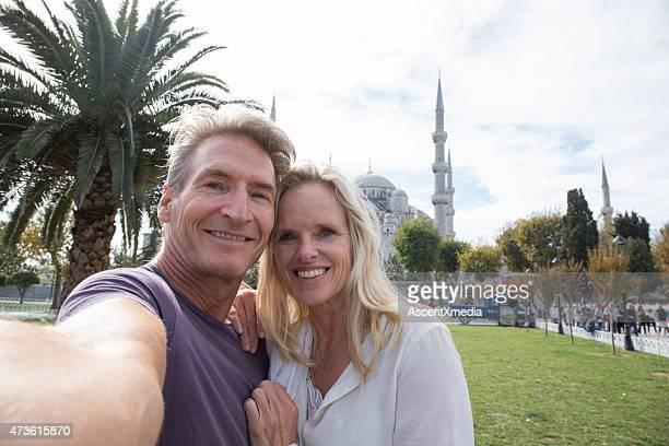 Couple take selfie portrait in front of Blue Mosque