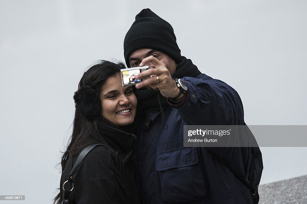 A couple takes a 'selfie' outside Rockefeller Center on November 19, 2013 in New York City. Oxford Dictionary named 'Selfie' the new word of the year. The word is defined as 'a photograph that one has taken of oneself, typically with a smartphone or webcam and uploaded to a social media website.' The terms 'binge-watch' and 'twerk' were shortlisted.
