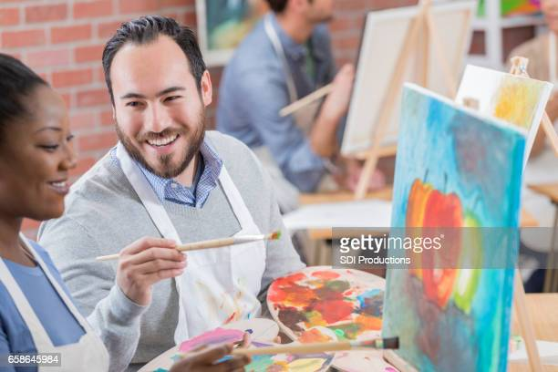 Couple takes art class together