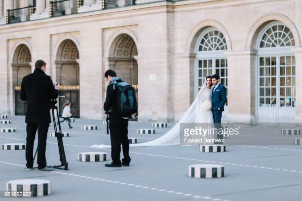 Couple takes wedding pictures at the 'Colonnes de Buren Les Deux Plateaux' at Palais Royal on October 30 2016 in Paris France All over the year...
