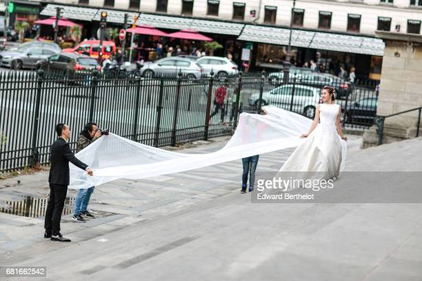 Couple takes wedding pictures at the Madeleine church on September 17 2016 in Paris France All over the year couples come to take pictures in front...