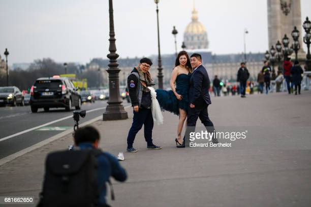 Couple takes wedding pictures on the bridge Alexandre III in front of the Invalides on March 12 2016 in Paris France All over the year couples come...