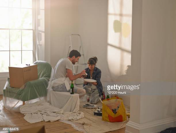 Couple taking a break from doing DIY in new home