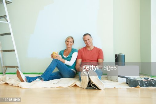 Couple Taking A Break From Painting Room : Stock Photo