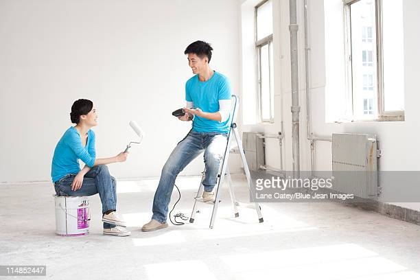 Couple taking a break from remodeling