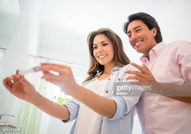 Couple taking a home pregnancy test