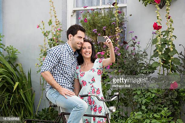 A couple taking a picture of themselves