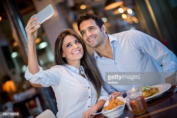 Couple taking a selfie at a restaurant