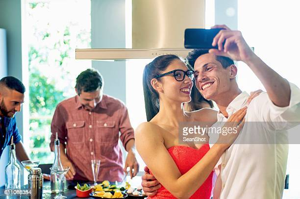 Couple Taking a Selfie during a Party in Kitchen