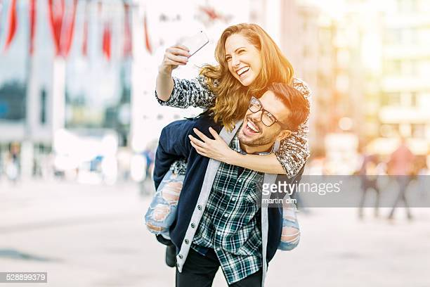 Couple taking a selfie in the city