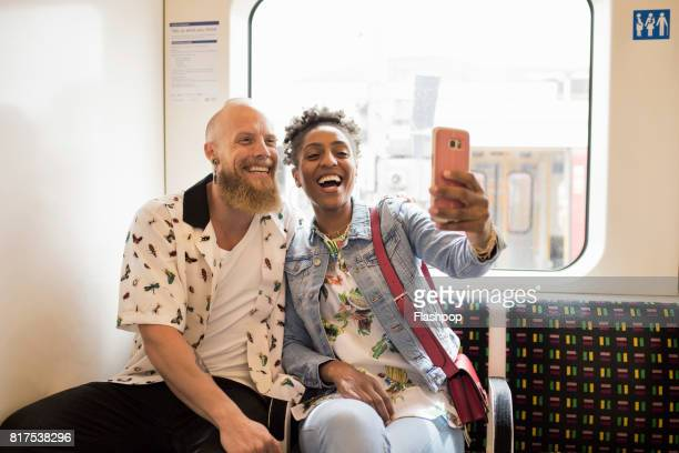 Couple taking a selfie on a train
