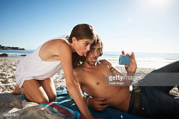 Couple taking a self-portrait with smart phone