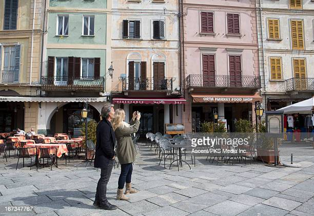 Couple taking cell picture in outdoor piazza