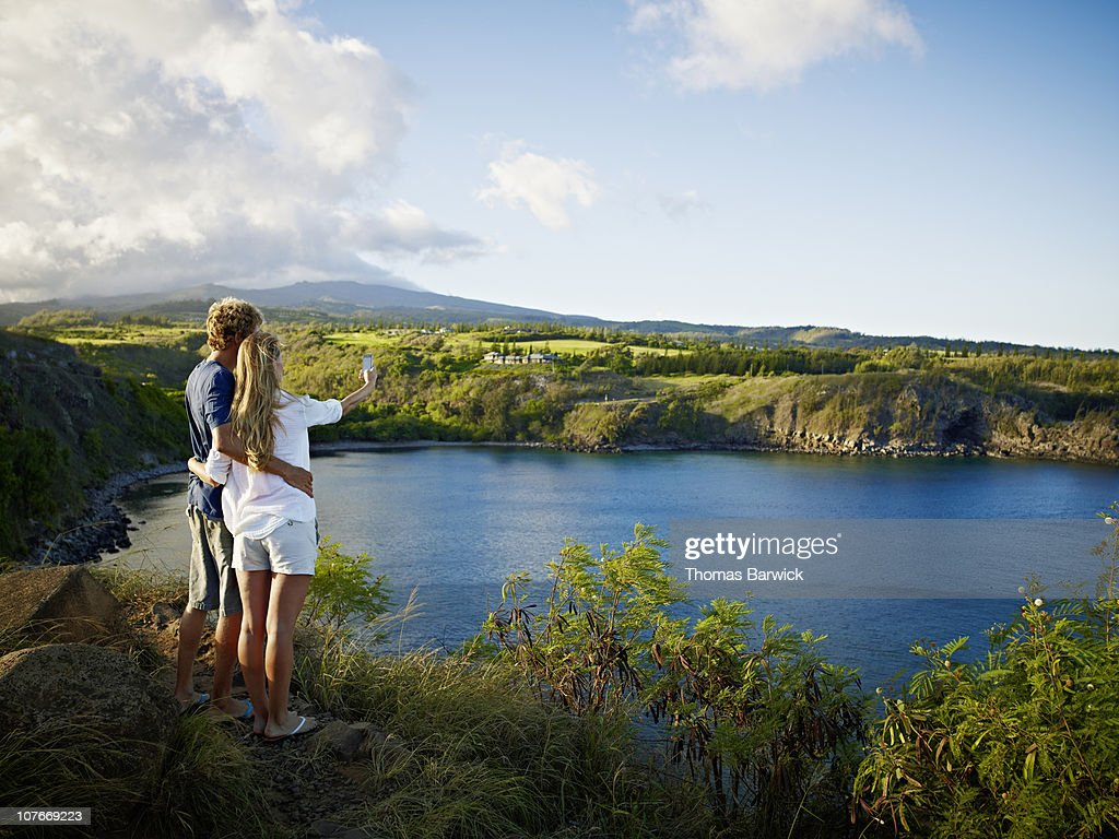 Couple taking digital photo with palm top : Stock Photo