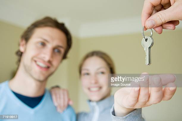 Couple taking keys