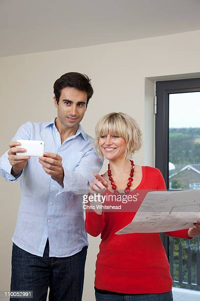 Couple taking photo in new apartment