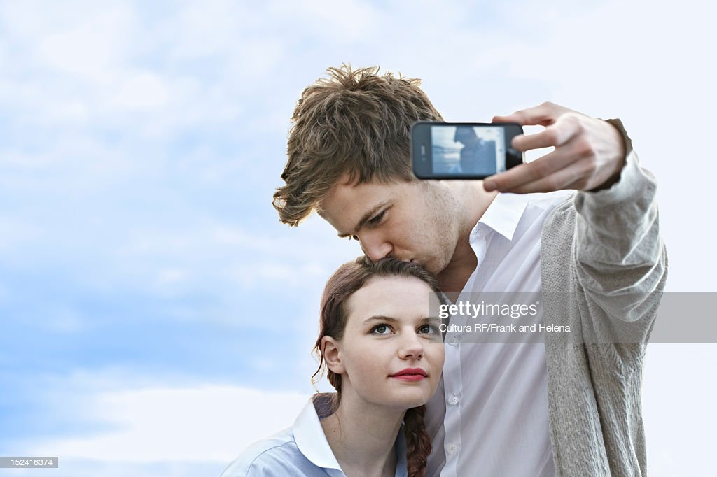 Couple taking picture of themselves : Stock Photo