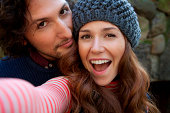 Couple taking picture together outdoors