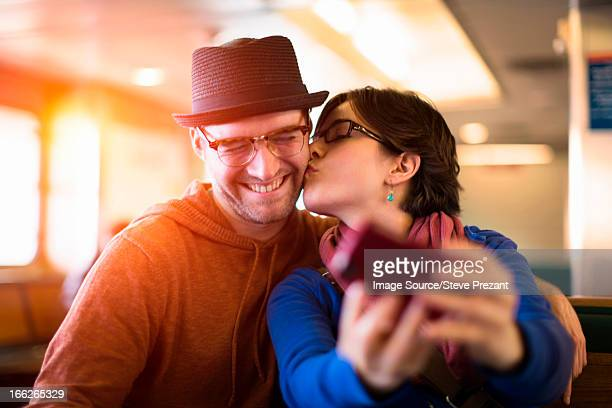 Couple taking picture with cell phone