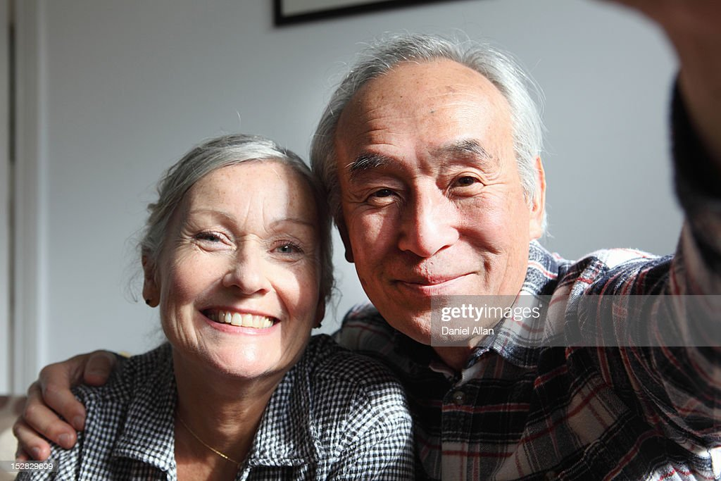 Couple taking pictures of themselves