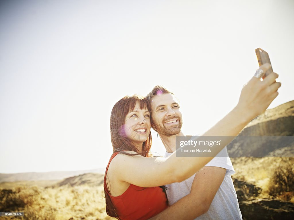 Couple taking self portrait with smartphone : Stock Photo