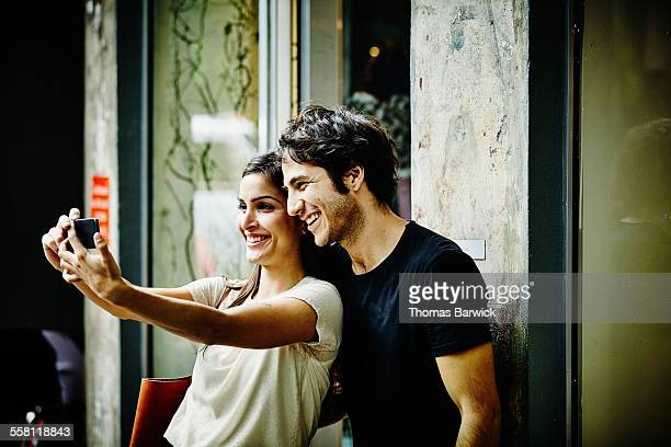 Couple taking self portrait with smartphone