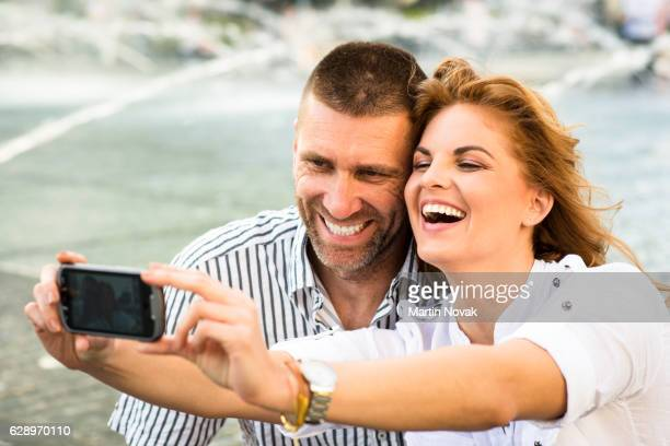 Couple taking selfie by mobile phone