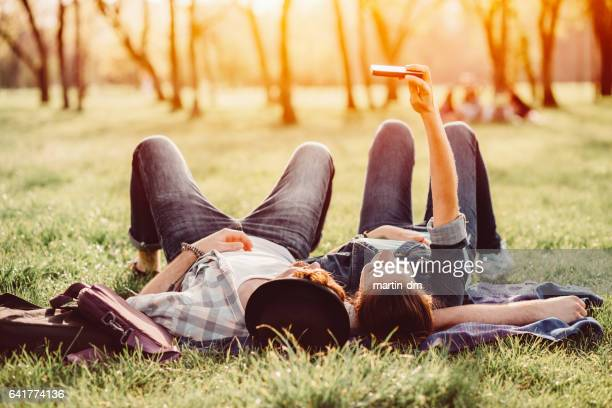 Couple taking selfie in the city park