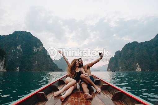Couple taking selfie on a longtail boat : Stock Photo