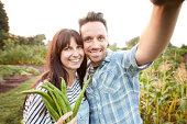 Couple taking selfie on allotment