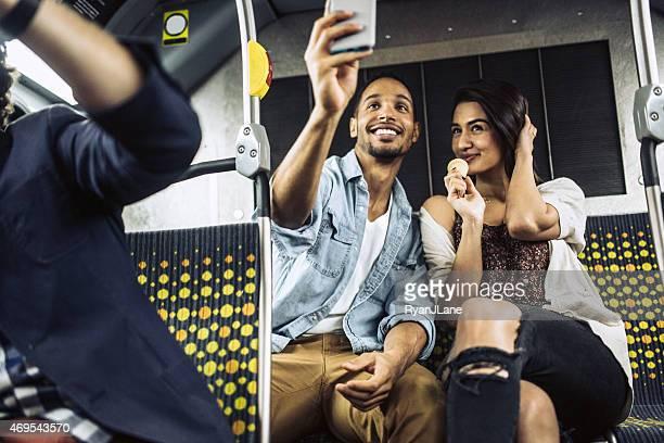 Couple Taking Selfie on City Metro Bus