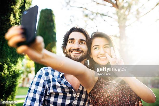 Couple Taking Selfie Outside