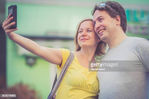 Couple taking selfies outdoors