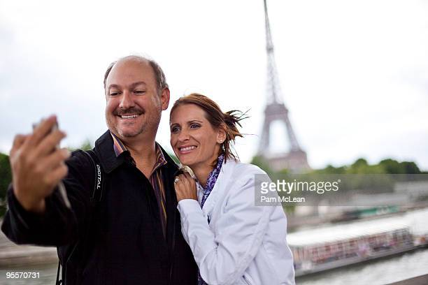 Couple taking self-portrait in Paris