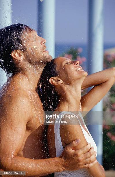 Couple taking shower outdoors