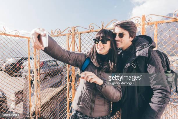 Couple taking smartphone selfie, Monte San Primo, Italy