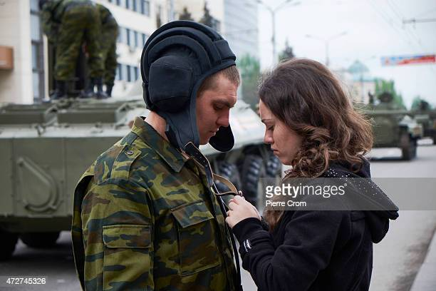 A couple talk as residents of Donetsk celebrate VE Day on May 9 2015 in Donetsk Ukraine Ceremonies are being held across Europe to mark 70 years...