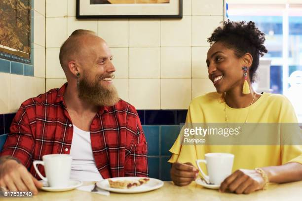 Couple talking and laughing in a cafe