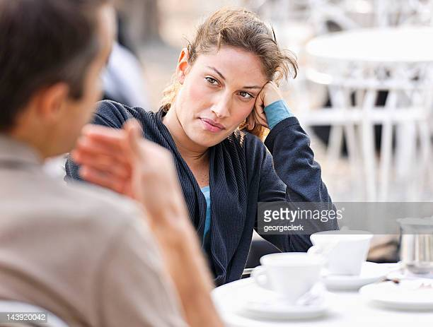 Couple Talking at a Cafe