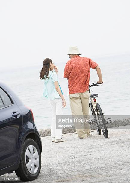 Couple talking at a seaside