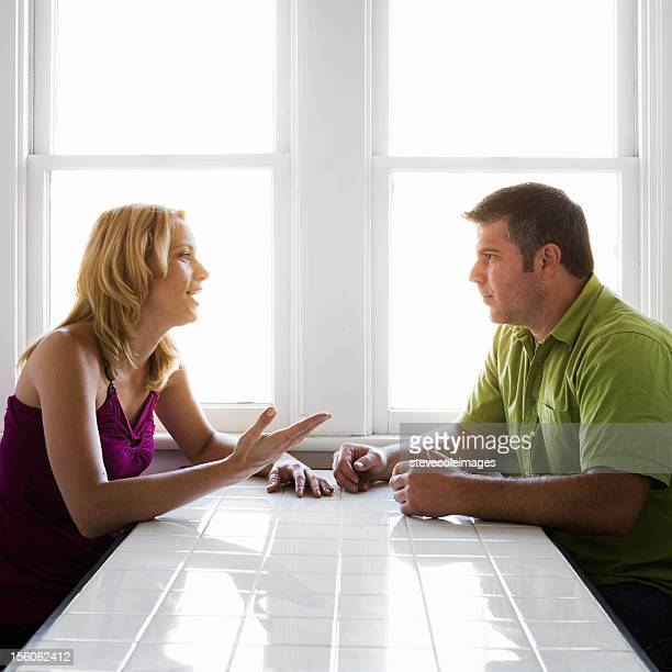 Couple Talking at Kitchen Table