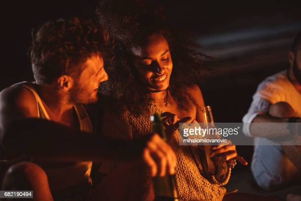 Couple talking, drinking and having a fun